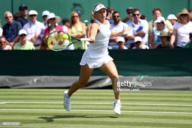 Daria Gavrilova of Australia returns against Caroline Dolehide of The United States during their Ladies' Singles first round match on day two of the...