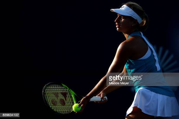 Daria Gavrilova of Australia serves to Dominika Cibulkova of Slovakia to win the Connecticut Open at Connecticut Tennis Center at Yale on August 26...