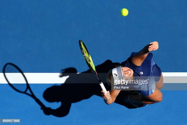 Daria Gavrilova of Australia serves to Eugenie Bouchard of Canada in her singles match on day 2 of the 2018 Hopman Cup at Perth Arena on December 31...
