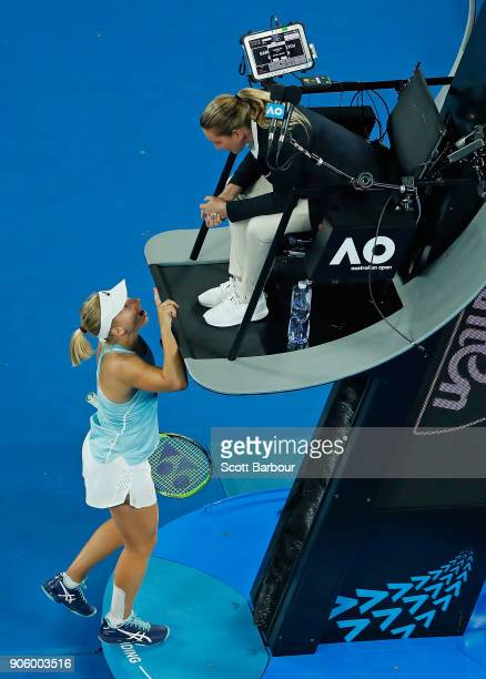 Daria Gavrilova of Australia speaks to the chair umpire after losing her second round match against Elise Mertens of Belgium on day three of the 2018...