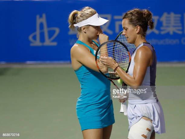 Daria Gavrilova of Australia talks tactics with Barbora Strycova of Czech Republic during the Ladies Doubles first round match against Nicole...