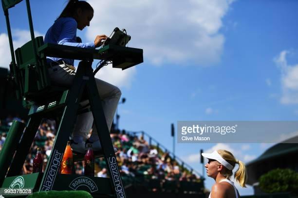 Daria Gavrilova of Australia talks to the chair umpire against Aliaksandra Sasnovich of Belarus during their Ladies' Singles third round match on day...