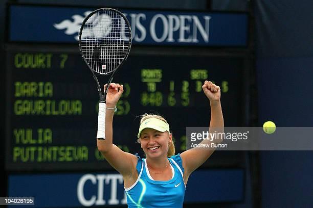 Daria Gavrilova of Russia celebrates defeating Yulia Putintseva of Russia to win her junior girls' singles final match on day fourteen of the 2010...
