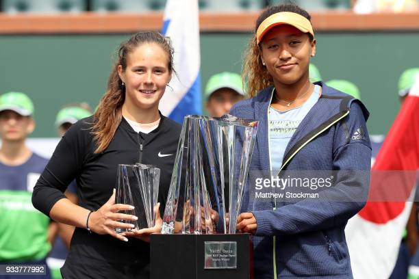 Daria Kasatkina of Russia and Naomi Osaka of Japan pose at the trophy ceremony during the women's final on Day 14 of the BNP Paribas Open at the...