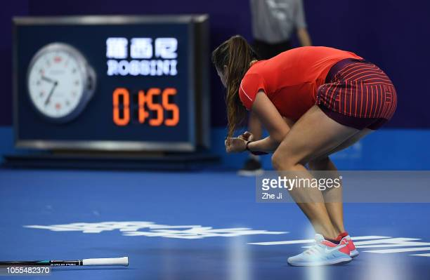 Daria Kasatkina of Russia celebrates after defeating Qiang Wang of China during the women's singles 1st Round match of the 2018 WTA Elite Trophy...