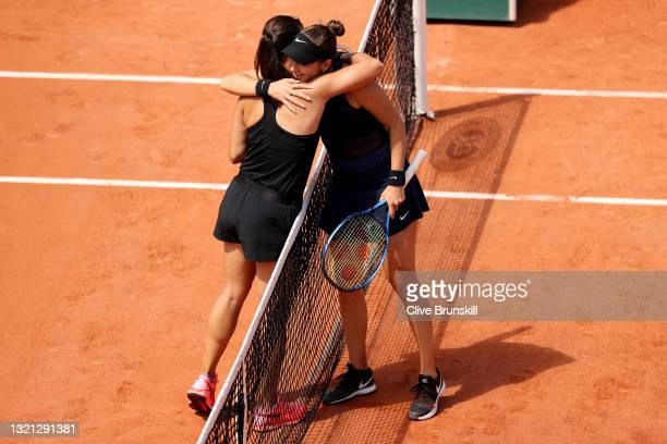 Daria Kasatkina of Russia embraces Belinda Bencic of Switzerland after winning her women's second round match during day four of the 2021 French Open...