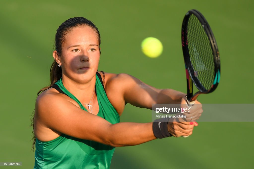 Daria Kasatkina of Russia hits a return against Maria Sakkari of Greece during day two of the Rogers Cup at IGA Stadium on August 7, 2018 in Montreal, Quebec, Canada.