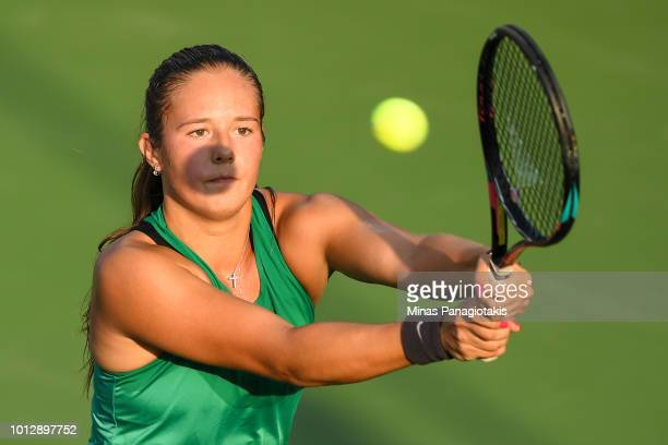 Daria Kasatkina of Russia hits a return against Maria Sakkari of Greece during day two of the Rogers Cup at IGA Stadium on August 7, 2018 in...