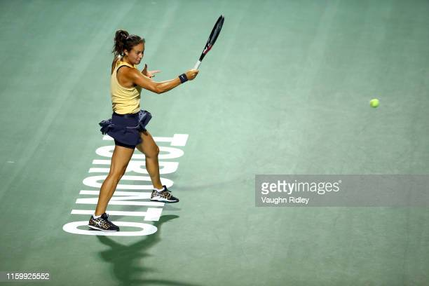 Daria Kasatkina of Russia hits a shot against Angelique Kerber of Germany during a first round match on Day 3 of the Rogers Cup at Aviva Centre on...