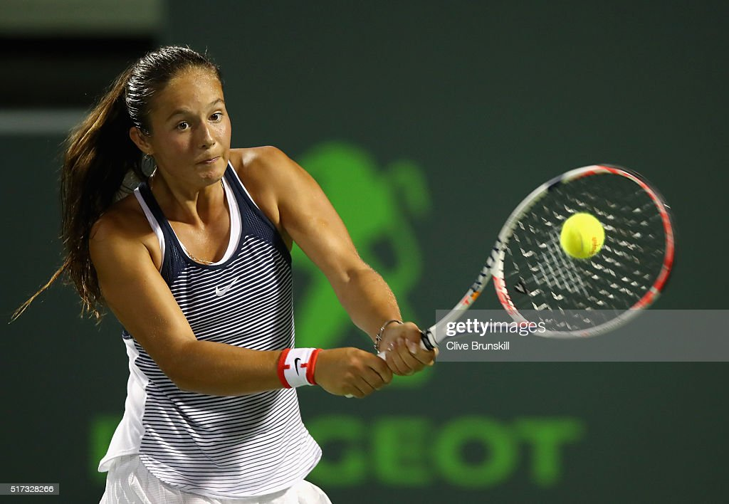 Daria Kasatkina of Russia plays a backhand against Simona Halep of Romania in their second round match during the Miami Open Presented by Itau at Crandon Park Tennis Center on March 24, 2016 in Key Biscayne, Florida.