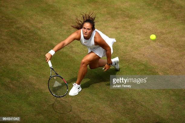 Daria Kasatkina of Russia plays a forehand against Alison Van Uytvanck of Belgium during their Ladies' Singles fourth round match on day seven of the...