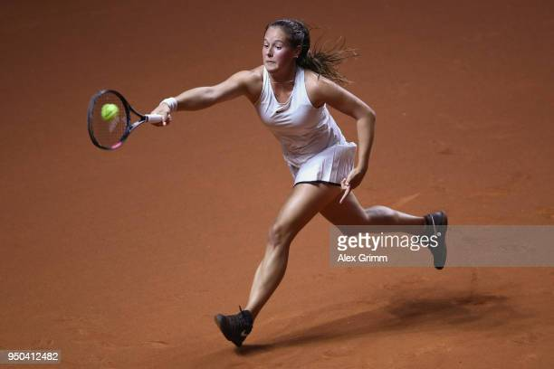Daria Kasatkina of Russia plays a forehand during her match against Magdalena Rybarikova of Czech Republic during day 1 of the Porsche Tennis Grand...