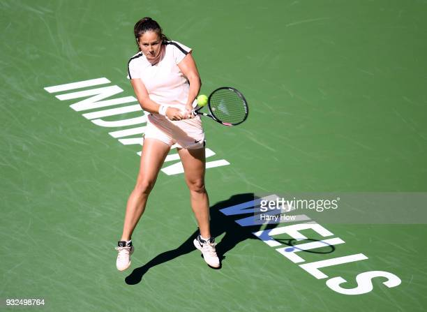 Daria Kasatkina of Russia returns a backhand in her match against Angelique Kerber of Germany during the BNP Paribas Open at the Indian Wells Tennis...
