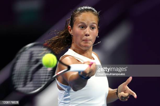 Daria Kasatkina of Russia returns a forehand against Garbine Muguruza of Spain during Day 1 of the WTA Qatar Total Open 2020 at Khalifa International...