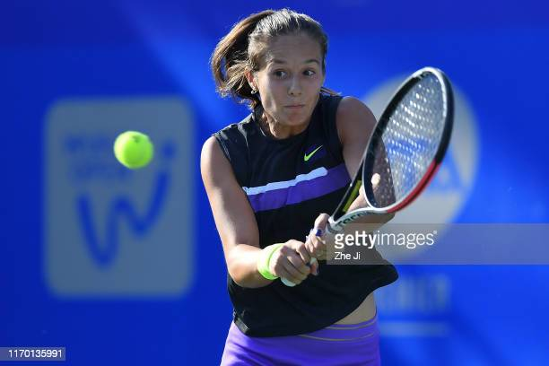 Daria Kasatkina of Russia returns a shot during the match against Caroline Garcia of France on Day 1 of 2019 Dongfeng Motor Wuhan Open at Optics...