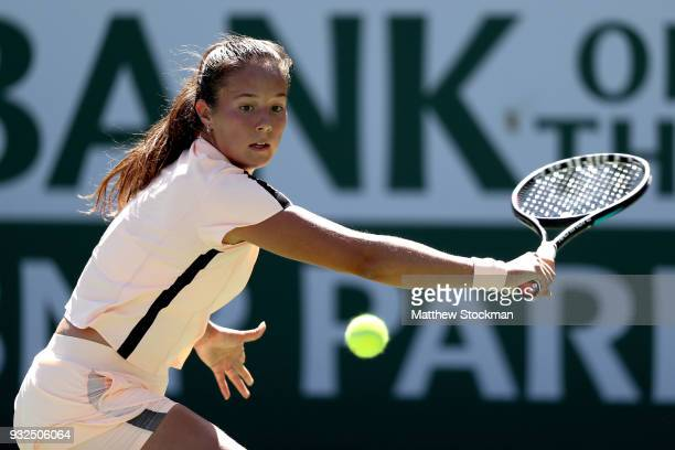 Daria Kasatkina of Russia returns a shot to Angelique Kerber of Germany during the quarterfinals of the BNP Paribas Open at the Indian Wells Tennis...