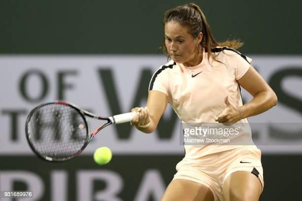 Daria Kasatkina of Russia returns a shot to Caroline Wozniacki of Denmark during the BNP Paribas Open at the Indian Wells Tennis Garden on March 13...