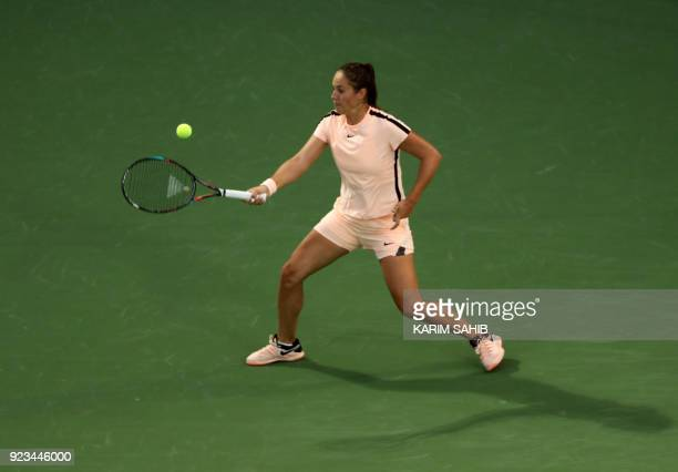 Daria Kasatkina of Russia returns the ball to Garbine Muguruza of Spain during their semifinal match at the WTA Dubai Duty Free Tennis Championship...