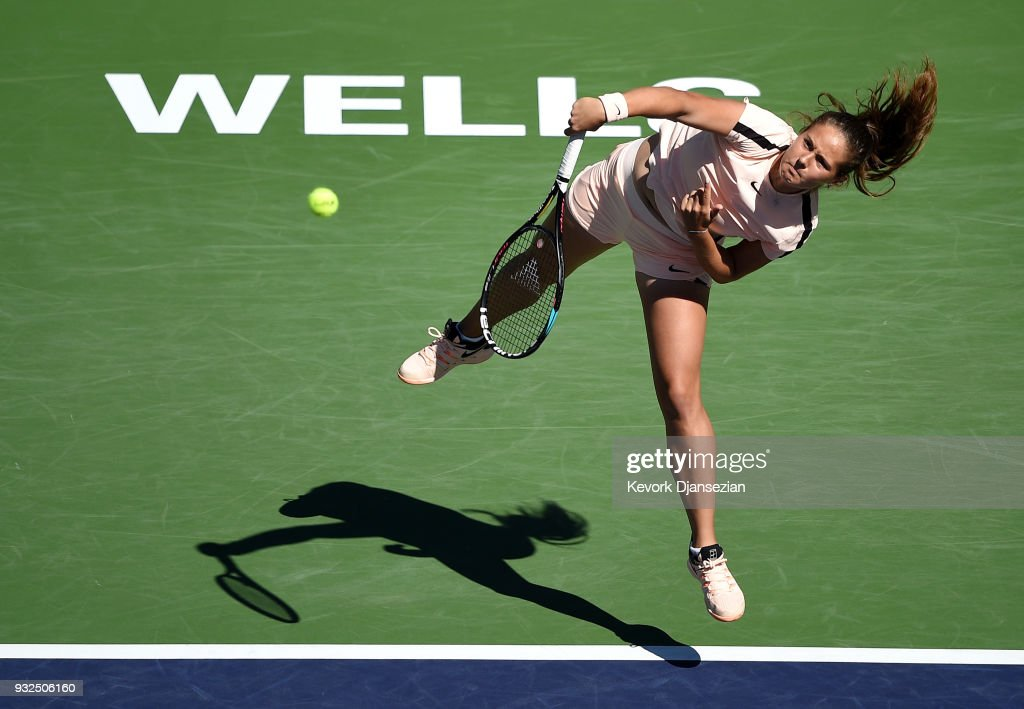 Daria Kasatkina of Russia serves against Angelique Kerber of Germany during Day 9 of BNP Paribas Open on March 15, 2018 in Indian Wells, California.