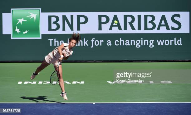 Daria Kasatkina of Russia serves against Naomi Osaka of Japan during the women's final on Day 14 of BNP Paribas Open on March 18 2018 in Indian Wells...