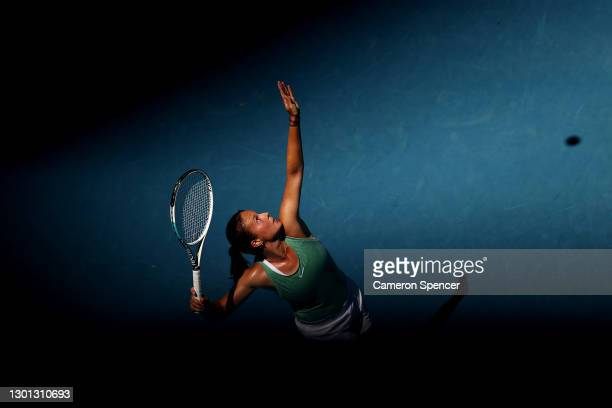 Daria Kasatkina of Russia serves in her Women's Singles second round match against Aryna Sabalenka of Belarus during day three of the 2021 Australian...