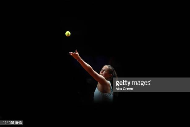 Daria Kasatkina of Russia serves the ball to Elise Mertens of Belgium during their first round match on day 2 of the Porsche Tennis Grand Prix at...