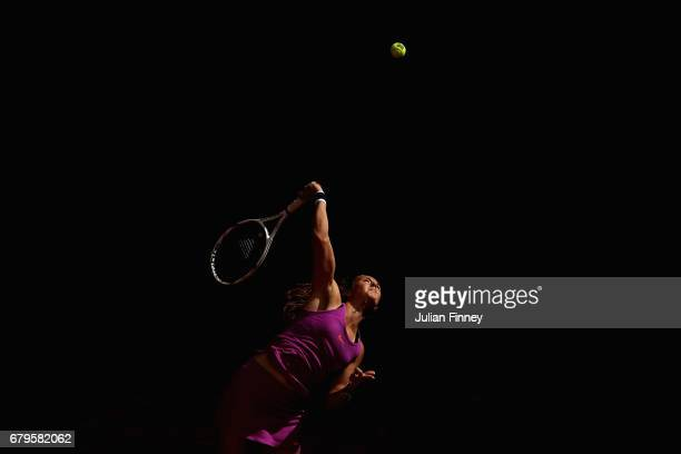 Daria Kasatkina of Russia serves to Roberta Vinci of Italy during day one of the Mutua Madrid Open tennis at La Caja Magica on May 6, 2017 in Madrid,...