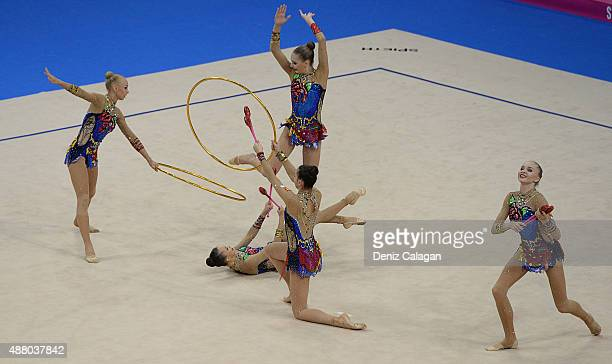 Daria Kleshcheva Anastasiia Maksimova Sofya Skomorokh Anastasiia Tatareva and Maria Tolkacheva of Russia compete in the Group Apparatus Clubs and...