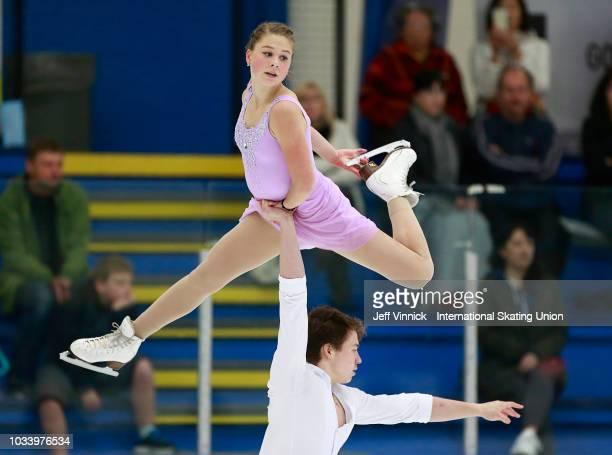 Daria Kvartalova and Alexei Sviatchenko of Russia perform during their bronze medal junior pairs final skate during the 2018 Junior Grand Prix of...