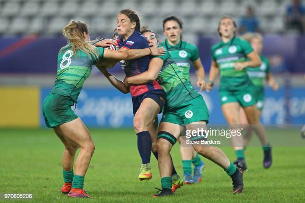 Daria Noritsina of Russia is tackled by Aoife Doyle and Deirbhile Nic A Bhaird of Ireland during the Trophy Final between Ireland and Russia during...