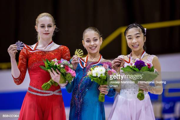Daria Panenkova of Russia Alena Kostornaia of Russia and Rino Kasakake of Japan pose in the Ladies medal ceremony during day two of the ISU Junior...