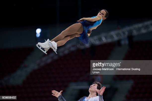 Daria Pavliuchenko and Denis Khodykin of Russia compete in the Junior Pairs Short Program during the World Junior Figure Skating Championships at...