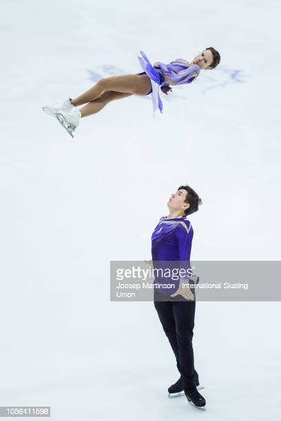 Daria Pavliuchenko and Denis Khodykin of Russia compete in the Pairs Short Program during day one of the ISU Grand Prix of Figure Skating at the...