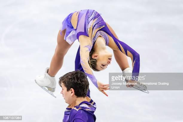 Daria Pavliuchenko and Denis Khodykin of Russia compete in the Pairs Short Program during day one of the ISU European Figure Skating Championships at...