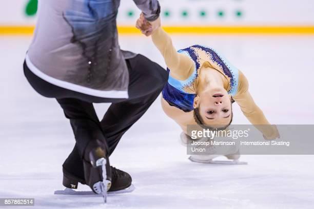 Daria Pavliuchenko and Denis Khodykin of Russia compete in the Pairs Short Program during day one of the ISU Junior Grand Prix of Figure Skating at...