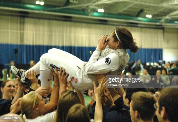 Daria Schneider of Columbia Bernard is lifted above her teammates shoulders after winning the women's saber competition during the Division I Women's...