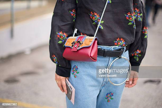 Daria Shapovalova poses with a Paula Cademartori bag after the Diesel Black Gold show during Milan Fashion Week Spring/Summer 2017 on September 23...