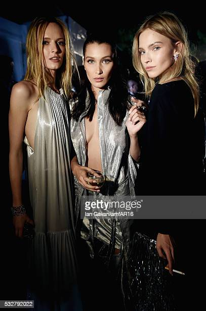 Daria Strokous Bella Hadid and Sasah Luss prepare backstage at the amfAR's 23rd Cinema Against AIDS Gala at Hotel du CapEdenRoc on May 19 2016 in Cap...