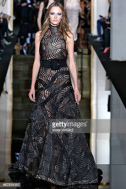 Daria Strokous walks the runway during the Versace show as part of Paris Fashion Week Haute Couture Spring/Summer 2015 on January 25 2015 in Paris...