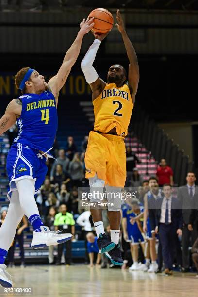 Darian Bryant of the Delaware Fightin Blue Hens commits a crucial foul on the final shot by Tramaine Isabell of the Drexel Dragons during the second...