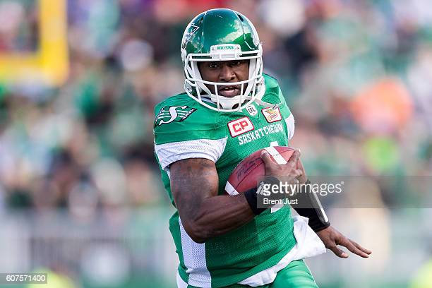 Darian Durant of the Saskatchewan Roughriders carries the ball in first half action of the game between the Edmonton Eskimos and Saskatchewan...