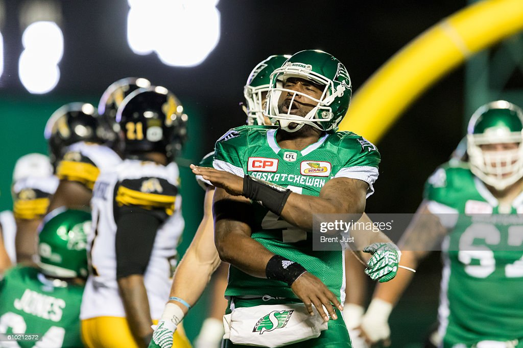 Darian Durant #4 of the Saskatchewan Roughriders celebrates after scoring a touchdown in the first half of the game between the Hamilton Tiger-Cats and Saskatchewan Roughriders at Mosaic Stadium on September 24, 2016 in Regina, Canada.