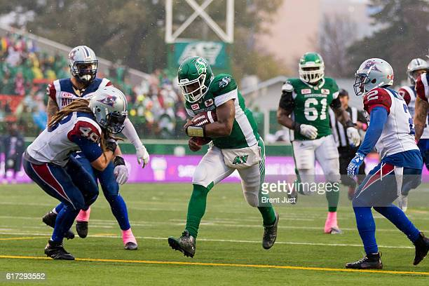 Darian Durant of the Saskatchewan Roughriders crosses the goal line for a touchdown in the game between the Montreal Alouettes and Saskatchewan...