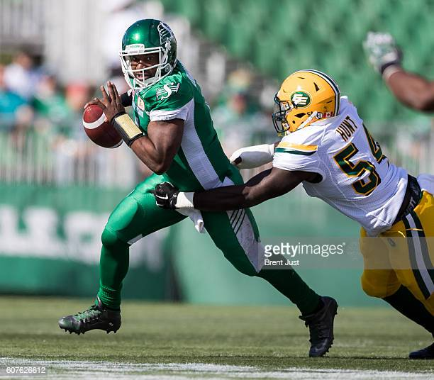 Darian Durant of the Saskatchewan Roughriders escapes from Phillip Hunt of the Edmonton Eskimos during the game between the Edmonton Eskimos and...