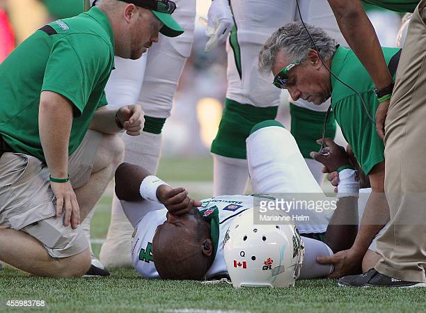 Darian Durant of the Saskatchewan Roughriders is seen to on the field after he was hurt in second half action in a CFL game against the Winnipeg Blue...