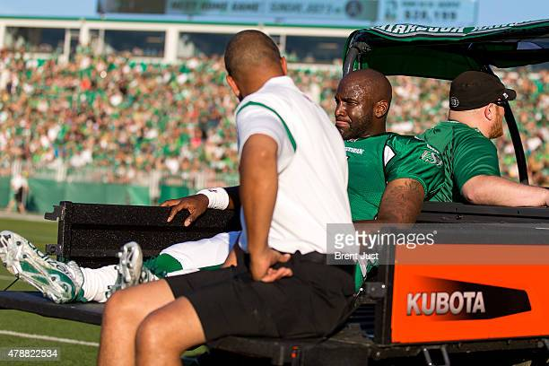 Darian Durant of the Saskatchewan Roughriders is taken off the field on a cart after being injured late in the first half of the game between the...