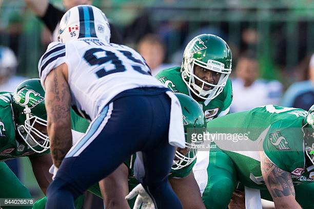 Darian Durant of the Saskatchewan Roughriders keeps an eye on Ricky Foley of the Toronto Argonauts during the game between the Toronto Argonauts and...