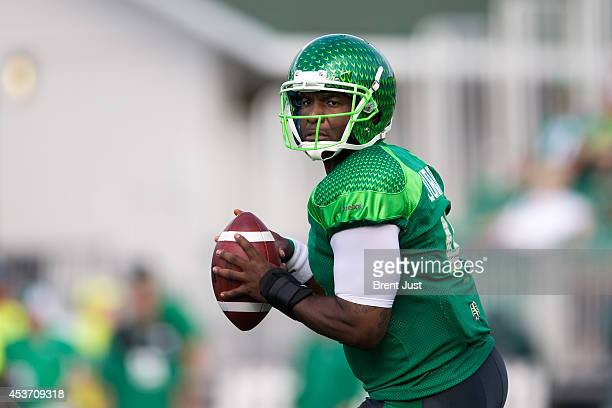 Darian Durant of the Saskatchewan Roughriders looks for a receiver downfield in a game between the Montreal Alouettes and Saskatchewan Roughriders in...