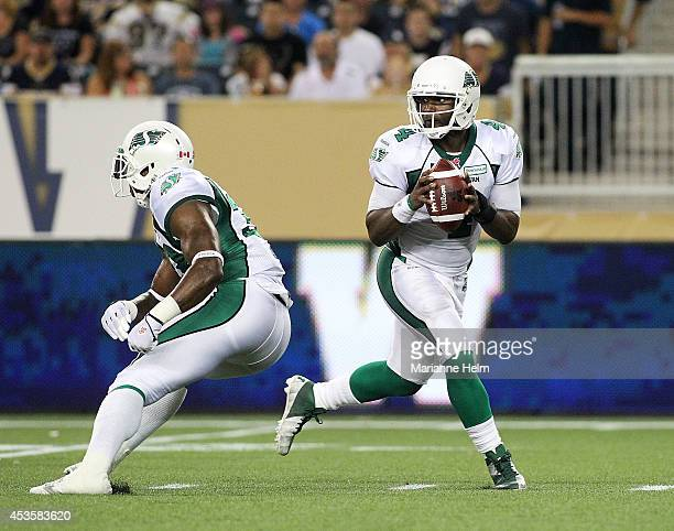Darian Durant of the Saskatchewan Roughriders prepares to throw the ball in CFL action during a game against the Winnipeg Blue Bombers at Investors...