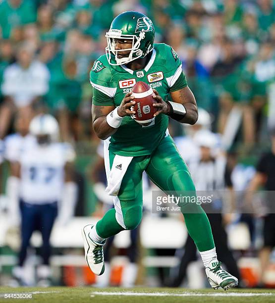 Darian Durant of the Saskatchewan Roughriders rolls out of the pocket in the game between the Toronto Argonauts and Saskatchewan Roughriders at...